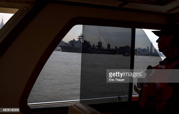 S Coast Guard auxiliary member looks out as the USS Oak Hill arrives on May 21 2014 in New York City Fleet Week festivities officially began with a...