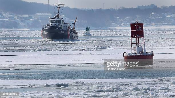 S Coast Guard boat breaks up ice flows in Hull Bay Boston Harbor has frozen and commerce on the vital waterways into the city has been slowed