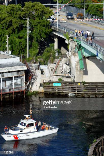 S Coast Guard boat keeps river traffic away from the bridge tender's house which lies on its side near the Flagler Street bridge over the Miami River...