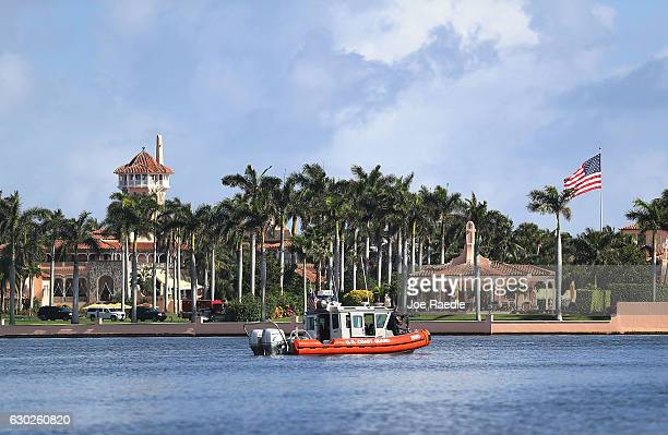 S Coast Guard boat passes in front of the MaraLago Resort where Presidentelect Donald Trump is staying as the 538 members of the Electoral College...