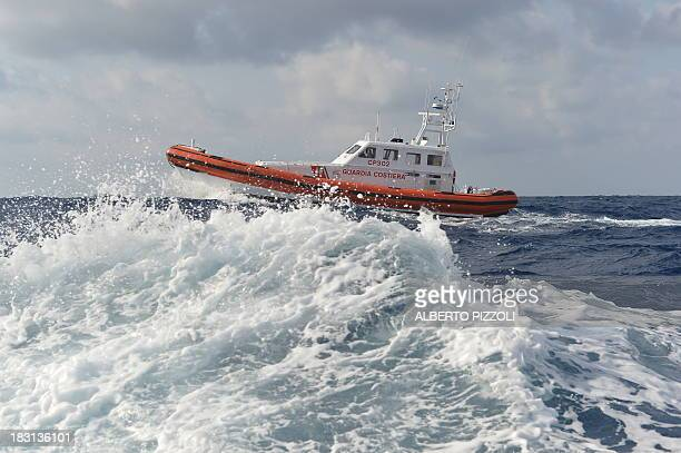 A Coast Guard boat patrols in the sea near the Lampedusa harbour on October 5 2013 after a boat with migrants sank killing more than a hundred of...