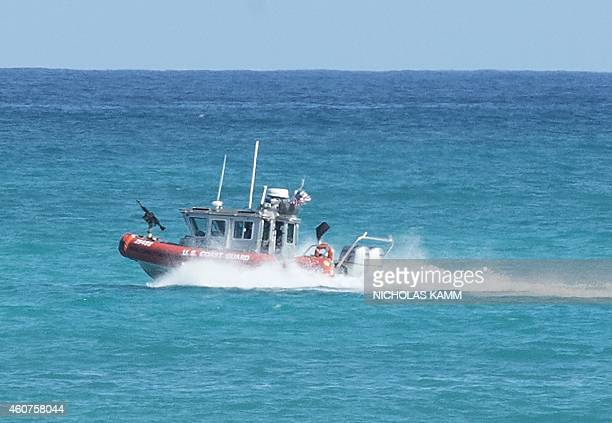 A Coast Guard boat patrols off the beach of Bellows Air Force Base near Honolulu on December 21 2014 as US President Barack Obama and his family...