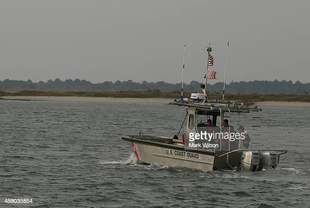 Coast Guard boat patrols the waters near NASA's Wallops Flight Facility October 29 2014 in Chincoteague Island Virginia Last night an unmanned...