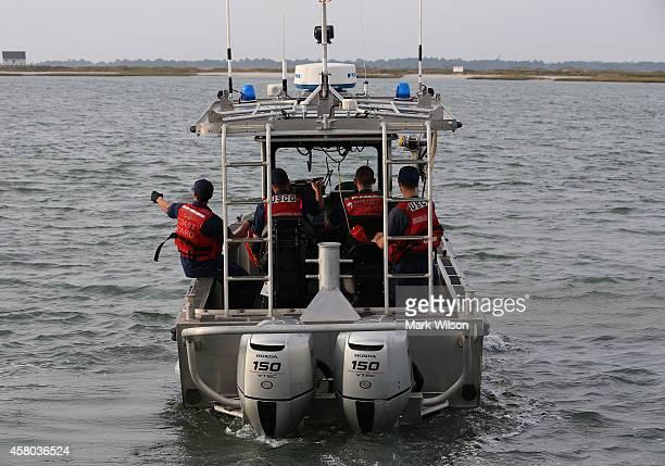 Coast Guard boat patrols the waters near NASA's Wallops Flight Facility on October 29 2014 in Chincoteague Island Virginia Last night an unmanned...