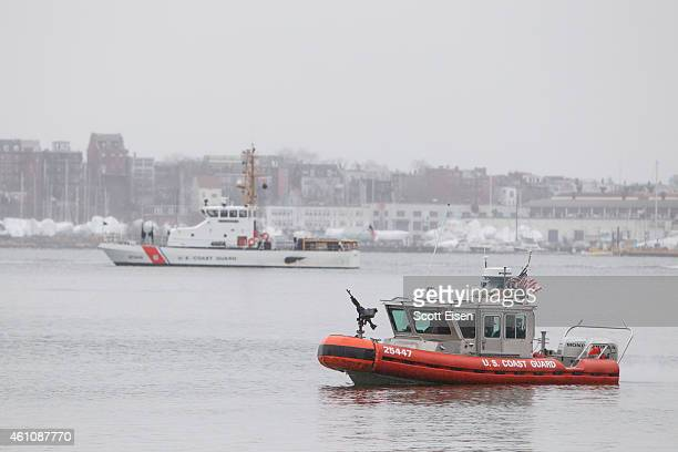 S Coast Guard boats patrol Boston Harbor outside of the Moakley Federal Courthouse on the second day of jury selection for the trail of Boston...