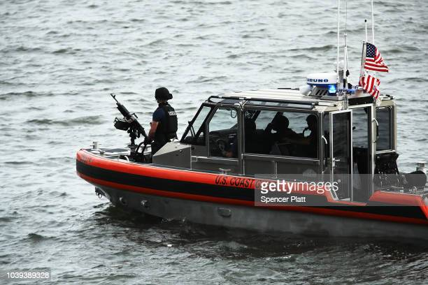 Coast Guard boats patrol the waters around the United Nations ahead of the official opening of the 73rd United Nations General Assembly on September...