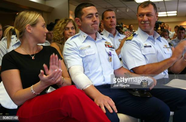 Coast Guard Boatswains Mate 3rd Class Joseph T. Ruggiero wears his Purple Heart after receiving it during an awards ceremony May 5, 2004 in Miami,...
