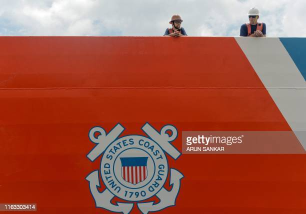 Coast Guard cadets look on as they stand on the deck of the USCG cutter ship 'Stratton' at Chennai port on August 23, 2019. - The United States Coast...
