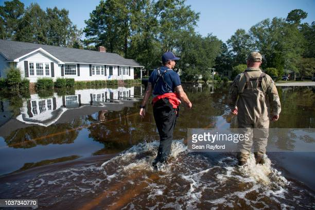 Coast Guard Chief Lorenzo Ladaga and Chris Blanchette survey rising floodwaters caused by Hurricane Florence near the Crabtree Swamp on September 21...
