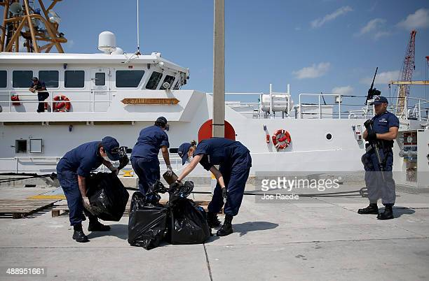 S Coast Guard crew members off load bags full of blocks of marijuana as they off load it from the Paul Clark one of the Coast Guard's newest...