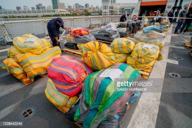 US Coast Guard crewmen prepare to offload bundles of drugs aboard the Coast Guard Cutter Bertholf on September 10 2020 in San Diego California The...