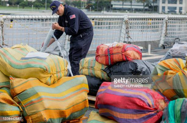 Coast Guard crewmen prepares to offload bundles of drugs aboard the Coast Guard Cutter Bertholf on September 10 2020 in San Diego California The crew...