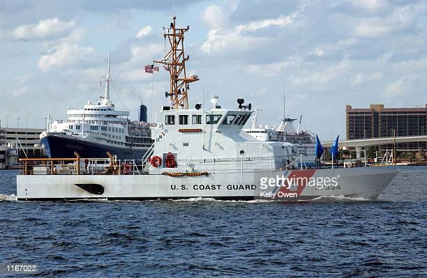 Coast Guard Cutter escorts the Ocean Breeze cruise liner Imperial Majesty out of Port Everglades October 2, 2001 in Fort Lauderdale, FL. Security at...