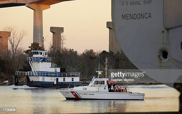 S Coast Guard cutter patrols the Savannah River while the USNS Mendonca is loaded with a cargo of Army vehicals and containers January 14 2003 at the...