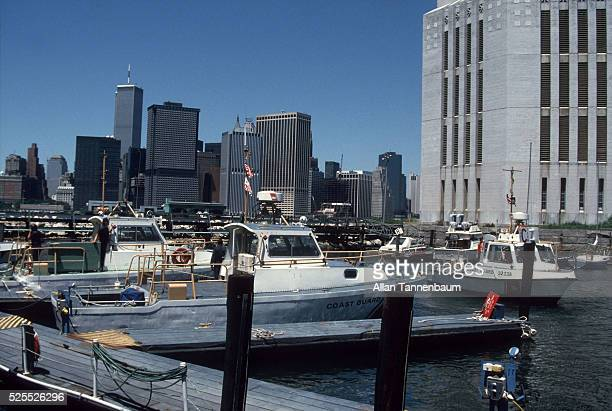 Coast Guard cutters at Governor's Island base in New York harbor with WTC in background provide security for Statue of Liberty Centennial Celebration...