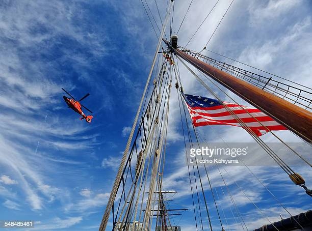 coast guard helicopter and tall ship - coast guard stock pictures, royalty-free photos & images