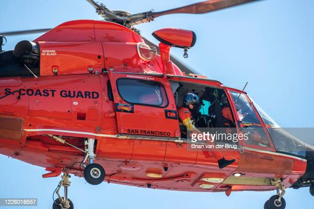 Coast Guard helicopter crew searchers the shoreline at Lake Piru for missing actress Naya Rivera on Thursday, July 9, 2020 in Lake Piru, CA.