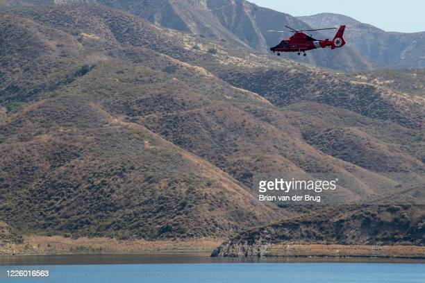 Coast Guard helicopter crew searchers the shoreline at Lake Piru for missing actress Naya Rivera on Thursday July 9 2020 in Lake Piru CA