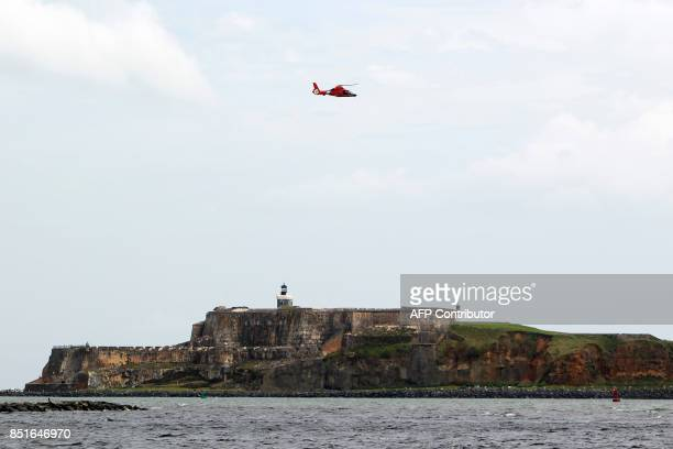 Coast Guard helicopter flies over El Morro Castle in the aftermath of Hurricane Maria in San Juan Puerto Rico on September 22 2017 Puerto Rico...