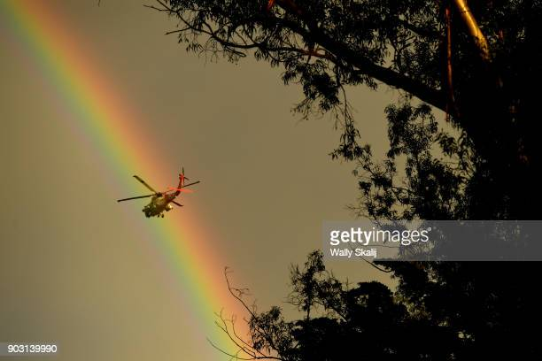 Coast Guard helicopter heads over Montecito after a major storm hit the burn area January 9 2018 in Montecito California