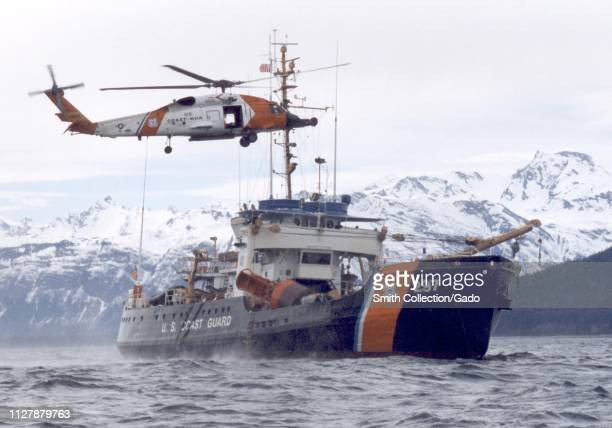 Coast Guard helicopter helps the cutter Ironwood offload equipment to Eldred Rock Lighthouse in Juneau, Alaska, United States, image courtesy of Navy...