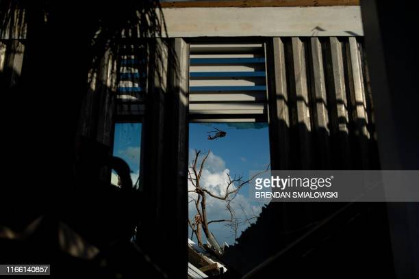 Coast Guard helicopter is seen after Hurricane Dorian on September 5 in Marsh Harbor Great Abaco Bahamas The death toll from Hurricane Dorian has...