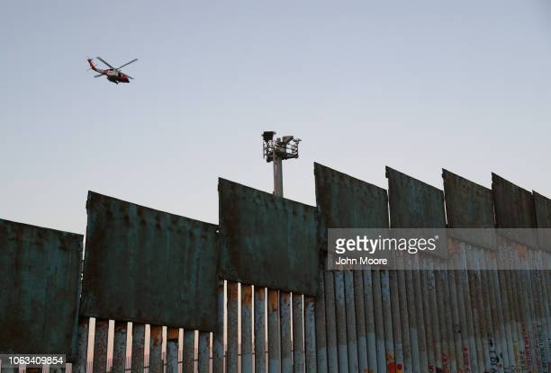 S Coast Guard helicopter patrols over the USMexico border on November 18 2018 in Tijuana Mexico Parts of the migrant caravan have been arriving to...