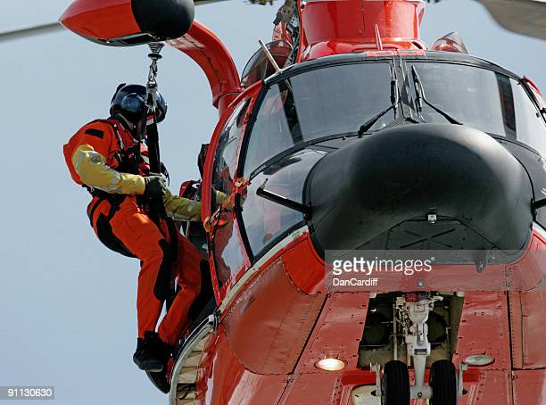 coast guard helicopter rescuer in san francisco - medevac stock photos and pictures