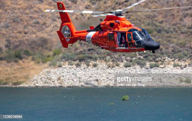 Coast Guard helicopter searches along the Lake Piru shoreline for missing actress Naya Rivera on Thursday, July 9, 2020 in Lake Piru, CA.