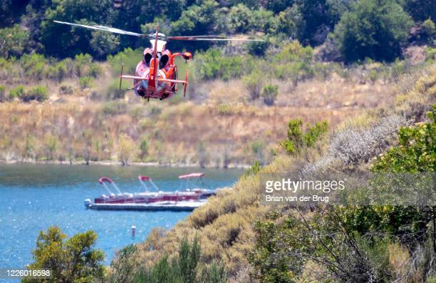 Coast Guard helicopter searches along the Lake Piru shoreline for missing actress Naya Rivera on Thursday July 9 2020 in Lake Piru CA