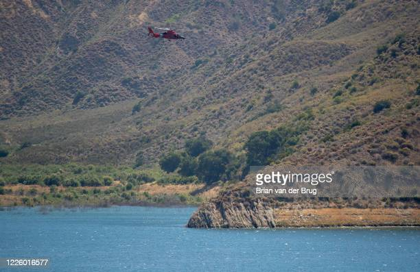 Coast Guard helicopter searches Lake Piru for missing actress Naya Rivera on Thursday, July 9, 2020 in Lake Piru, CA.