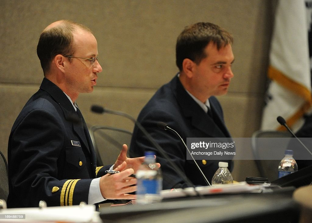 U.S. Coast Guard Lt. Commander Brain McNamara, left, questions Sean Churchfield, Shell Operation Manager for Alaska, not pictured, during a Coast Guard hearing on Saturday, May 25, 2013, in Anchorage, Alaska. The hearing focused on the grounding of the Shell Oil Company drill ship Kulluk in December 2012.