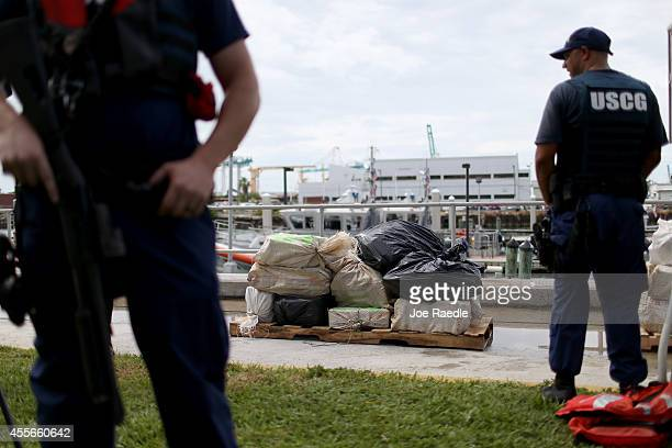 S Coast Guard members stand guard near bags containing approximately 719 kilograms of cocaine worth an estimated wholesale value of more than $23...