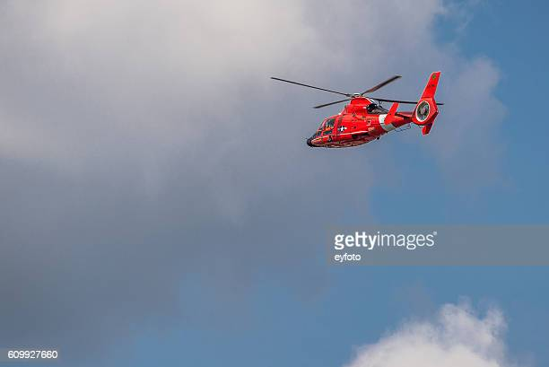 US Coast Guard MH-65C Dolphin Helicopter in Flight