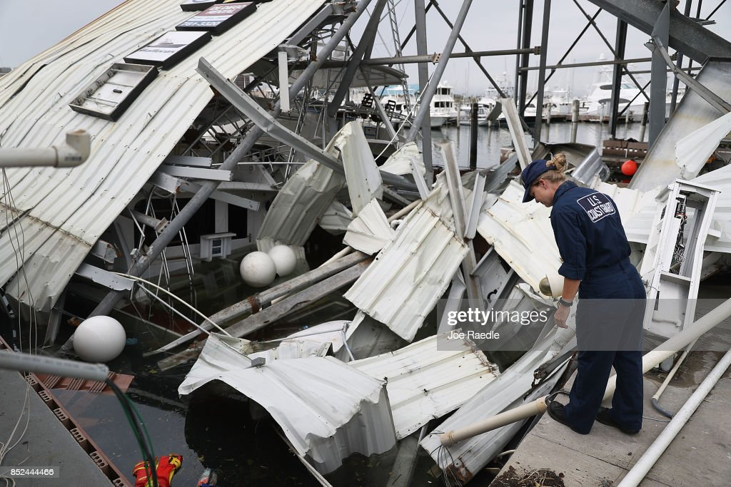 U.S. Coast Guard MST-2 Annaliese Ennis surveys the damage to a marina after Hurricane Maria passed through the area on September 23, 2017 in San Juan, Puerto Rico. Puerto Rico experienced widespread damage after Hurricane Maria, a category 4 hurricane, passed through.