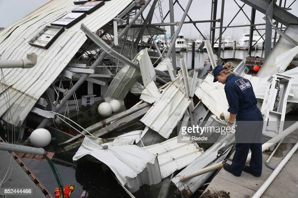 S Coast Guard MST2 Annaliese Ennis surveys the damage to a marina after Hurricane Maria passed through the area on September 23 2017 in San Juan...