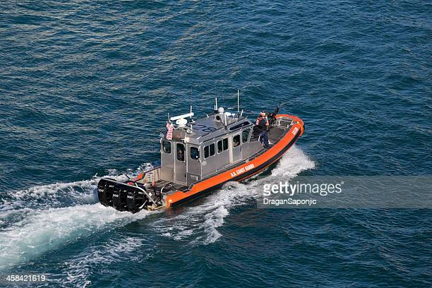 us coast guard on duty in the port of miami - coast guard stock pictures, royalty-free photos & images