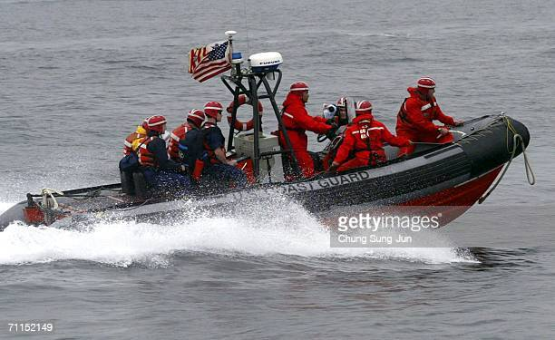 S Coast guard participates in an exercise of the North Pacific Coast Guard Forum on June 8 2006 in Busan South Korea Coastguards from South Korea...