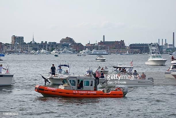 US Coast Guard performing securuity checks of pleasure craft at tall ship event, Boston, MA