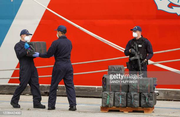 US Coast Guard personel unload bundles of seized drugs in front of the Cutter Bertholf on September 10 2020 in San Diego California The crew seized...