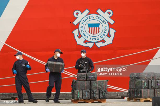 US Coast Guard personnel stand guard over bundles of seized drugs in front of the Cutter Bertholf on September 10 2020 in San Diego California The...