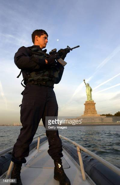 S Coast Guard Petty Officer Nicholas McConnell a 19yearsold member of the new US Coast Guard Maritime Safety and Security Teams stands guard on a...