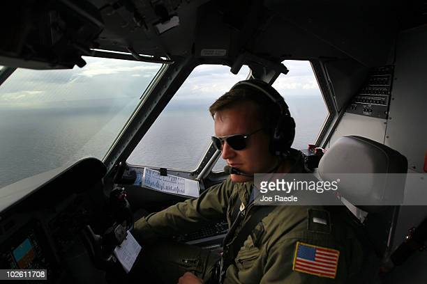 Coast Guard pilot Nathan Souleret flies over the gulf near where the efforts to recover oil and cap the Deepwater Horizon spill continue on July 3...