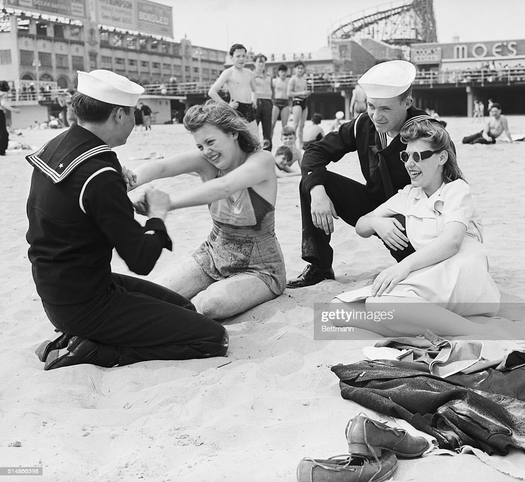 Coast Guard sailors Lawrence Bill and Stanley Gordon visit the beach at Brooklyn's Coney Island with girlfriends Mollie Martinsen and Judy Hansen while on leave in May 1943.