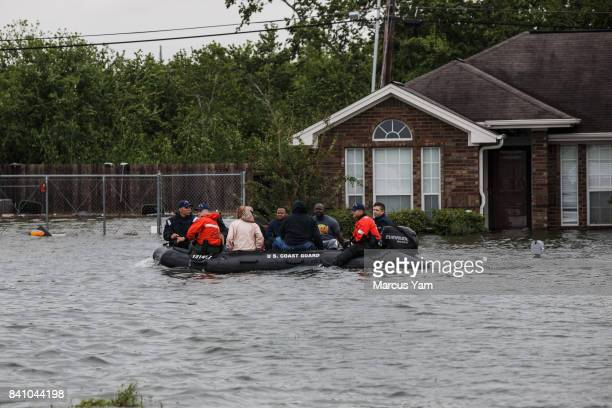 Coast Guard search and rescue boats retrieve people stranded in their flooded homes in Port Arthur Texas on Aug 30 2017