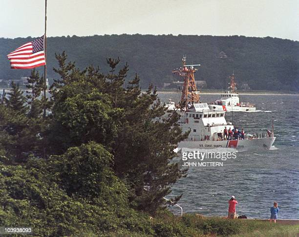 Coast Guard ships the Sanibel and the Hammerhead bring back members of the Kennedy and Bassette families from the USS Briscoe as it returns to the...