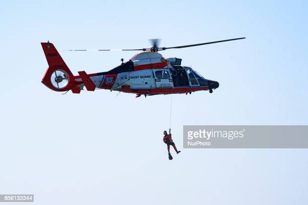 Coast Guard team during a search and rescue demonstration at the Breitling Airshow in Huntington Beach California on September 30 2017 The threeday...