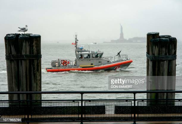 Coast Guard vessel patrols New York Harbor waters off Battery Park on January 5 in New York as the US government shutdown enters its third week While...
