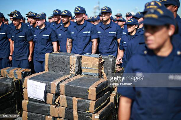 S Coast Guardsmen stand aboard the Cutter Boutwell with piles of confiscated cocaine seized during a 18 different interdictions off the coast of...