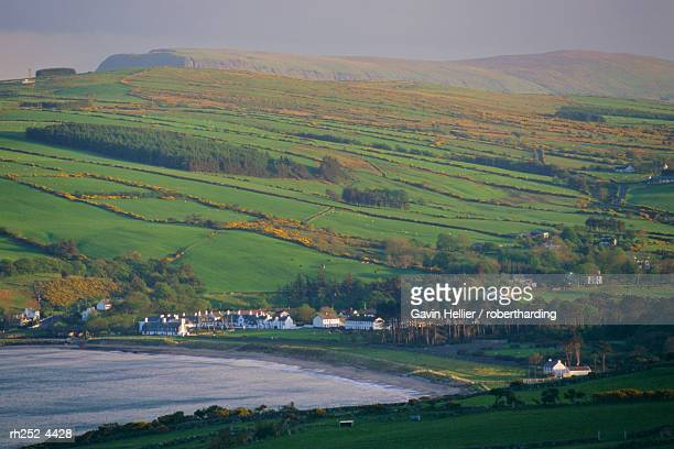 coast, hills and cushendun, county antrim, ulster, northern ireland, uk, europe - gavin hellier stock pictures, royalty-free photos & images